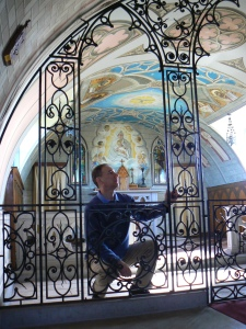 Philip Paris author observing the Rood Screen built by Italian POW soliders