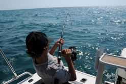 photo of man fishing